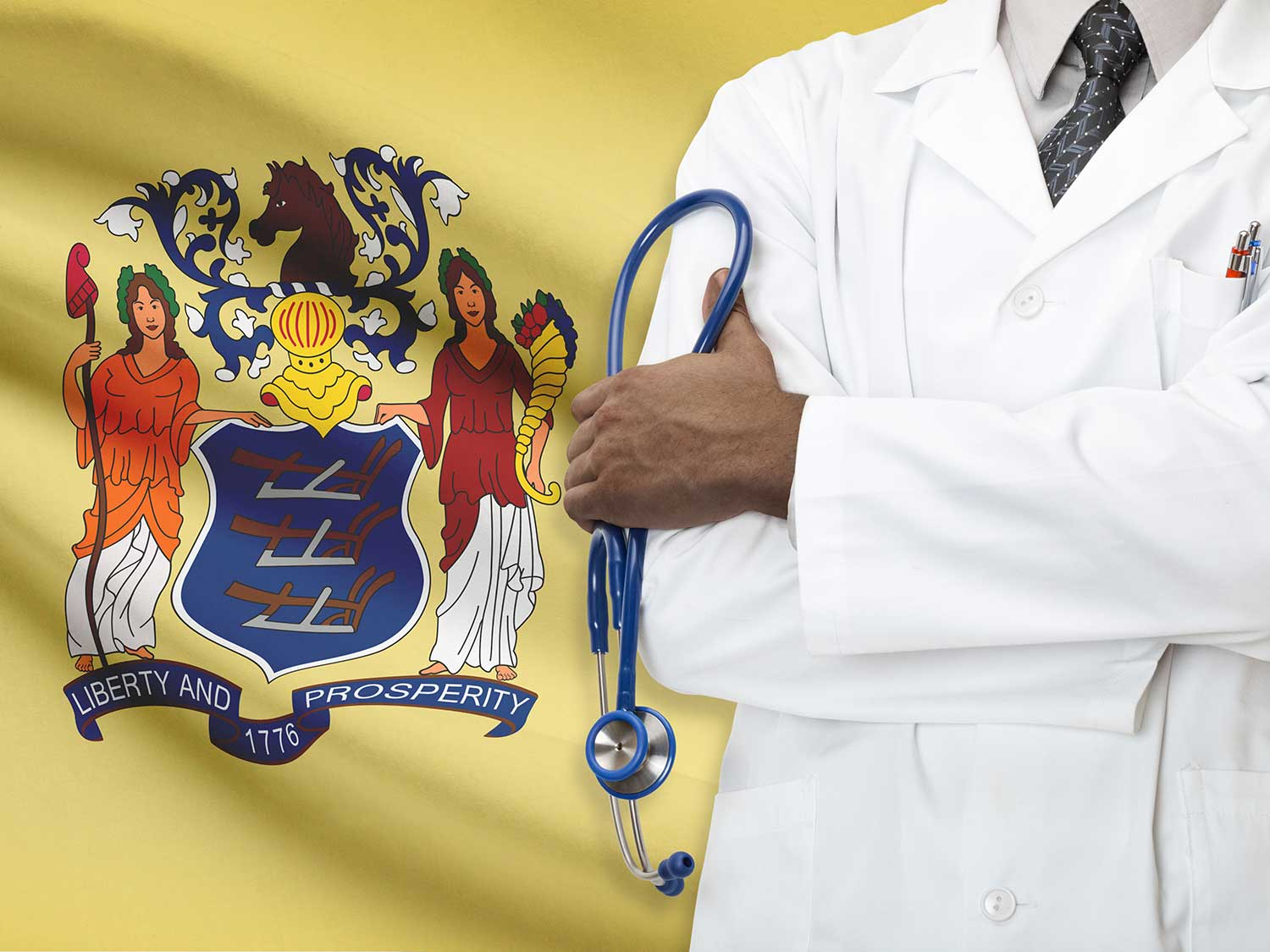 Doctor With Malpractice Liability Coverage Standing In Front Of A New Jersey Flag