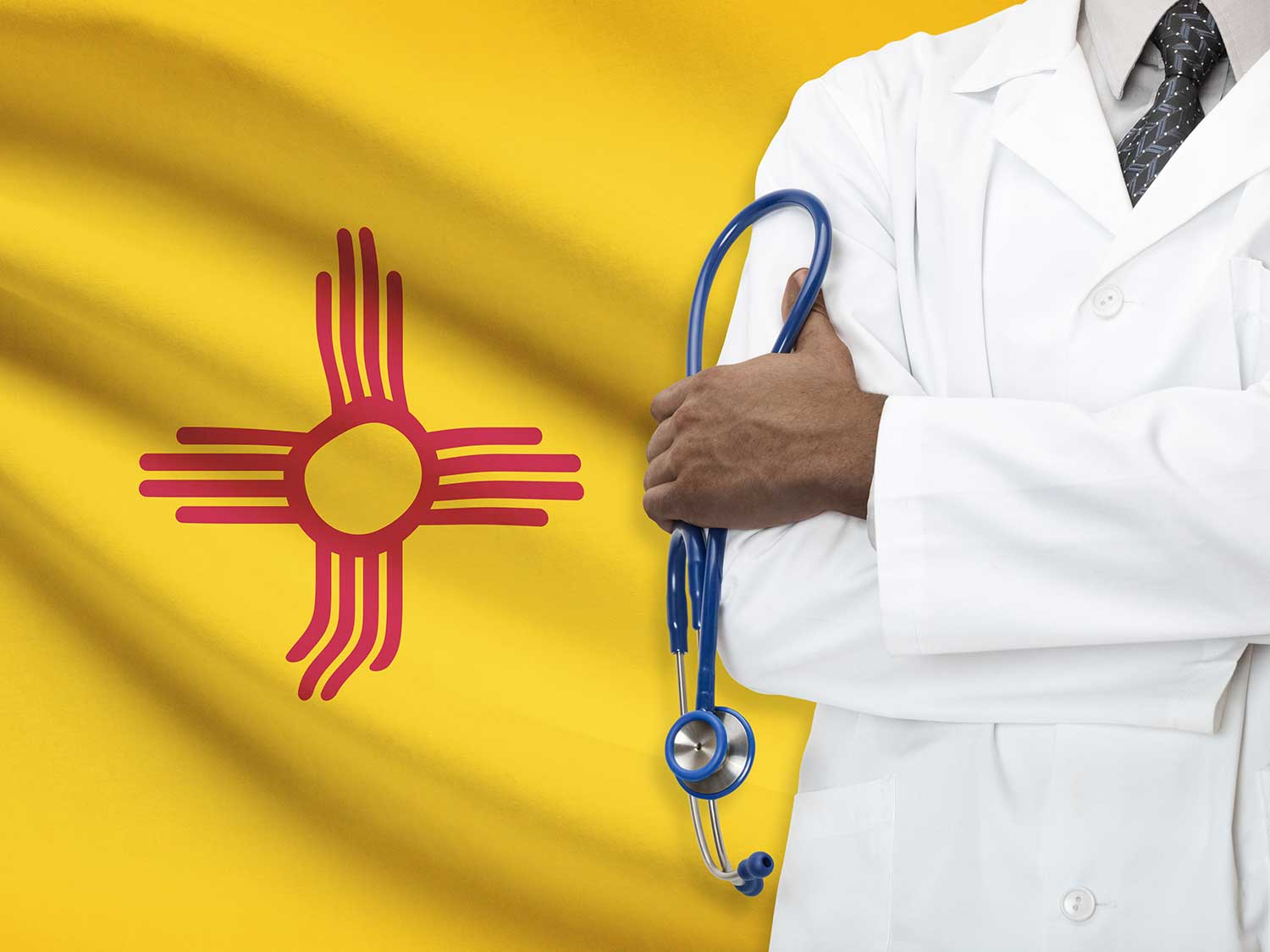 A Physician With Medical Malpractice Insurance Standing In Front Of The New Mexico State Flag